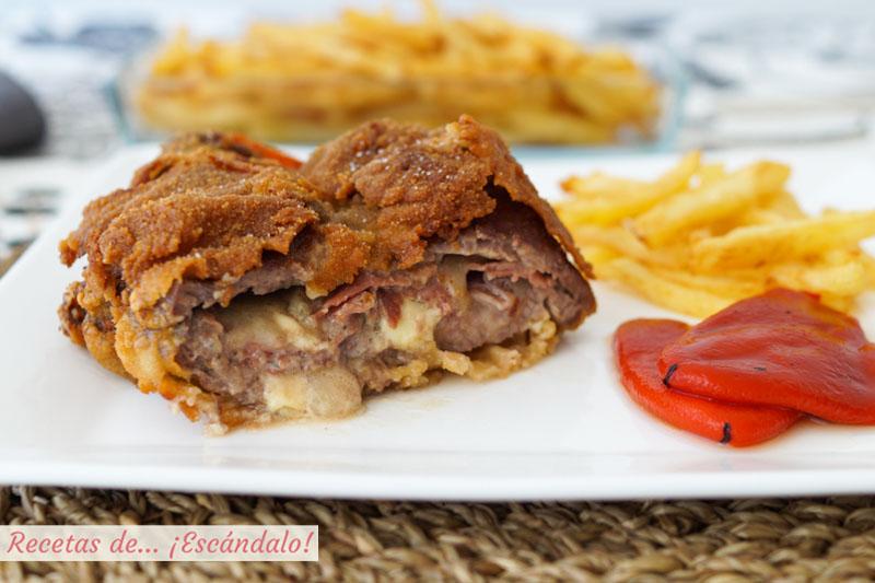 Cachopo asturiano de ternera con patatas fritas y pimientos del piquillo